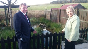 Alex views flooding with local resident Mrs Bennett