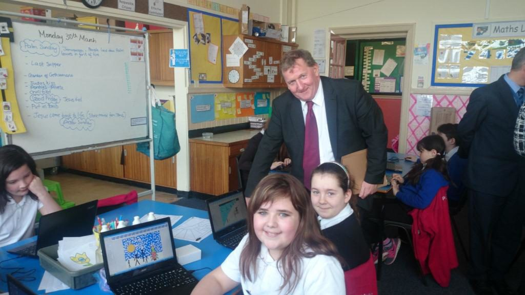 Kailya Reid and Jade Annal show Alex Rowley the programmes they are working on