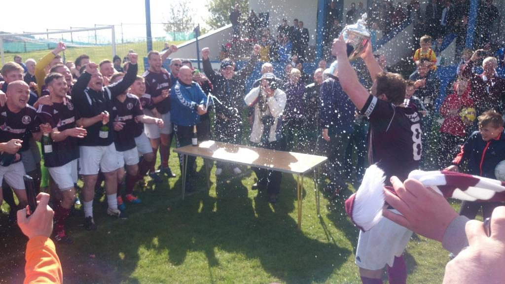 Kelty are presented with the Super League Trophy to the delight of the fans!
