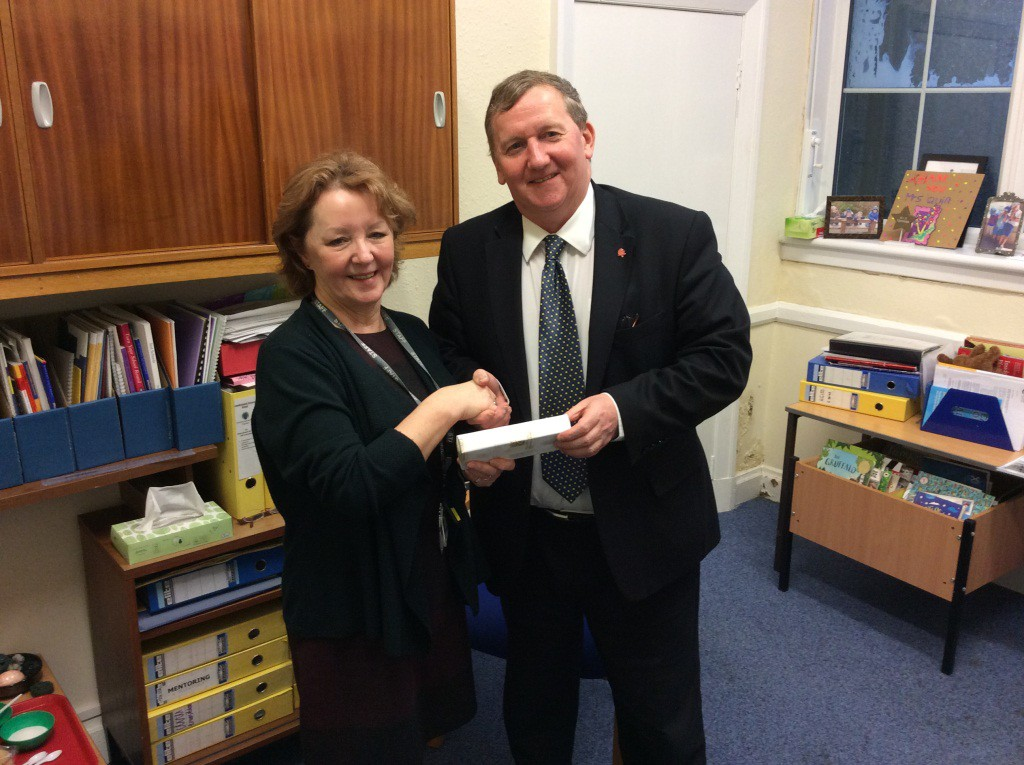 Alex Rowley hands over a gift and thanks Mrs Quinn for her service to Cowdenbeath and Fife